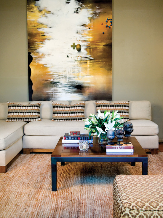 contemporary-living-room-with-modern-coffee-table-decorations-also-unique-baby-head-statues-also-flower-table-centerpieces-also-beige-couch-color-also-light-brown-carpet-color-also-a