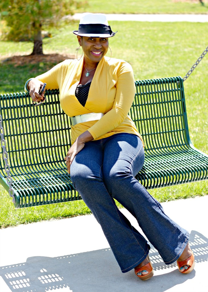 Flare jeans and belted yellow cardigan 18