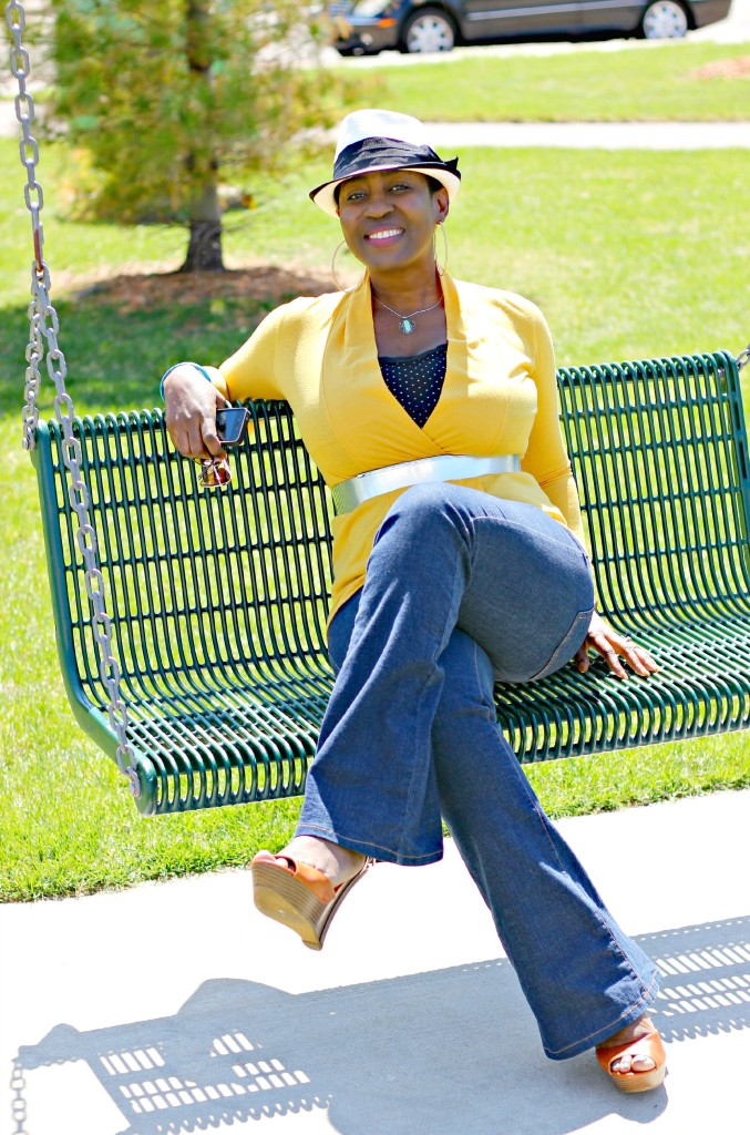 Flare jeans and belted yellow cardigan 20