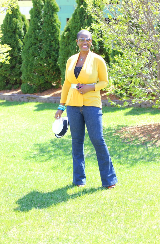 Flare jeans and belted yellow cardigan 23