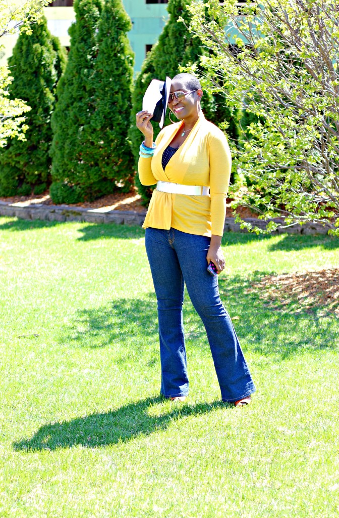 Flare jeans and belted yellow cardigan 24
