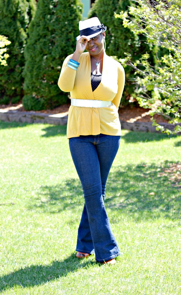 Flare jeans and belted yellow cardigan 25