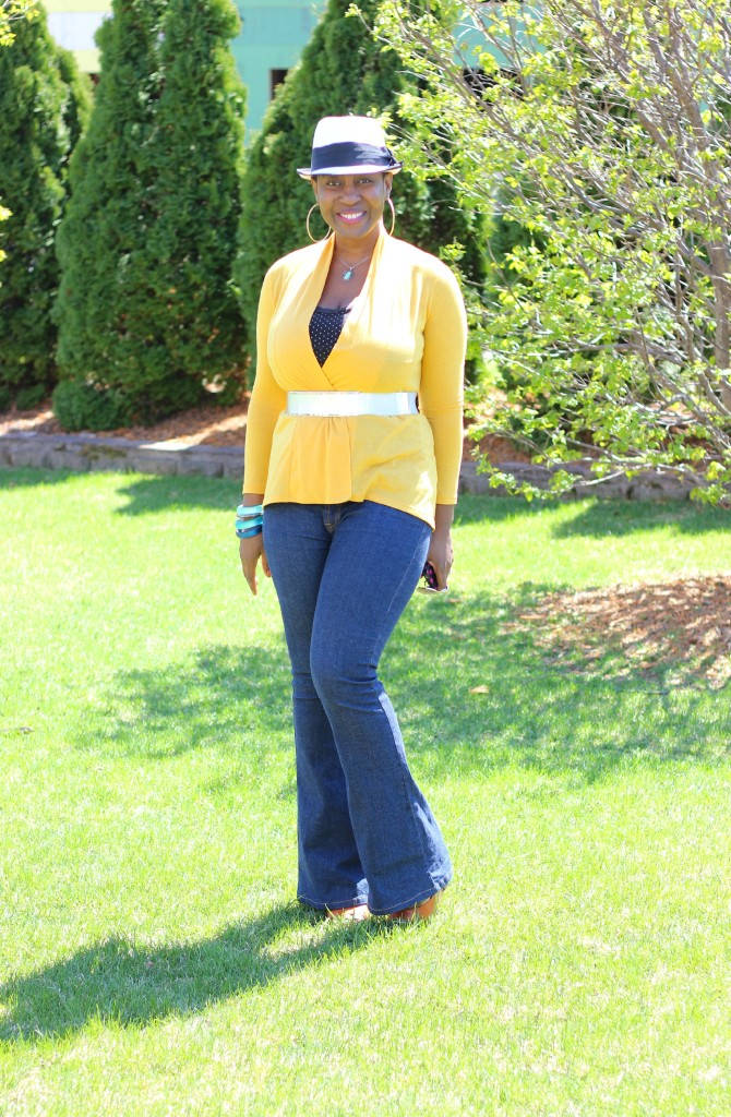 Flare jeans and belted yellow cardigan 26