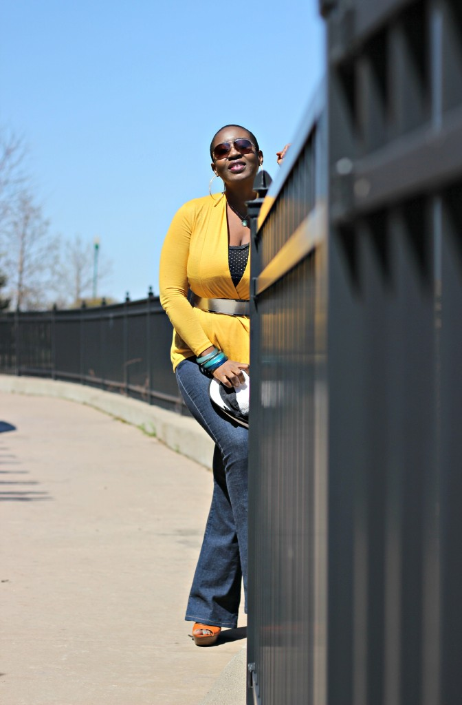 Flare jeans and belted yellow cardigan