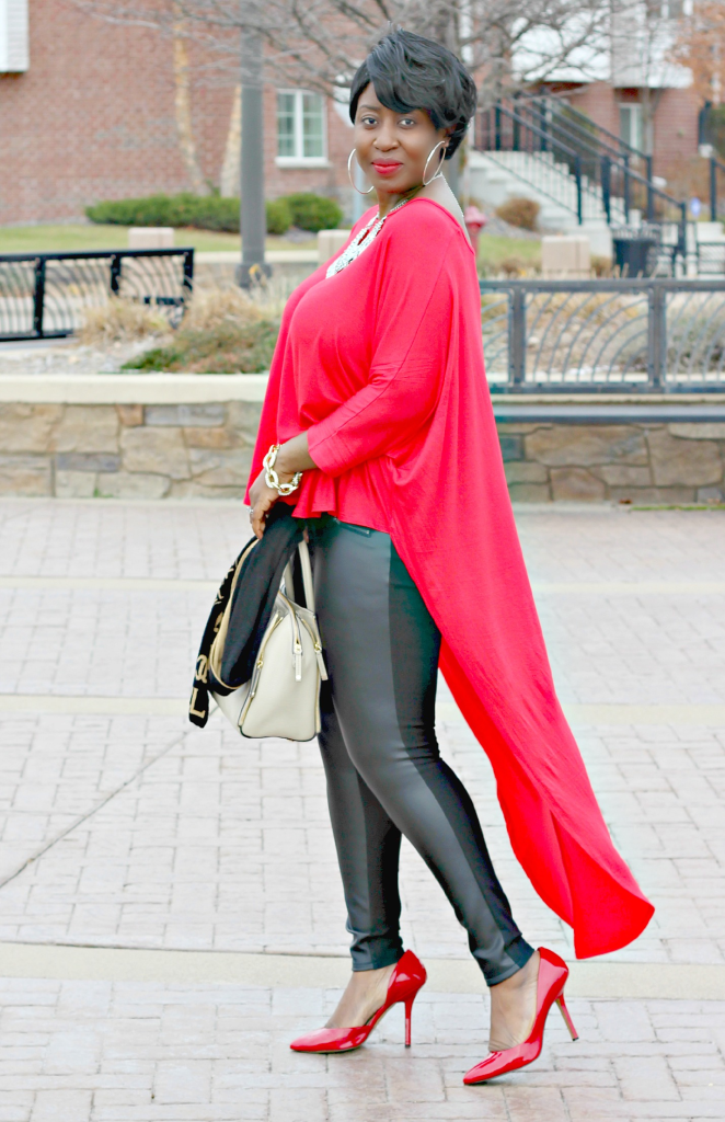 Red high low duster and black leather pants