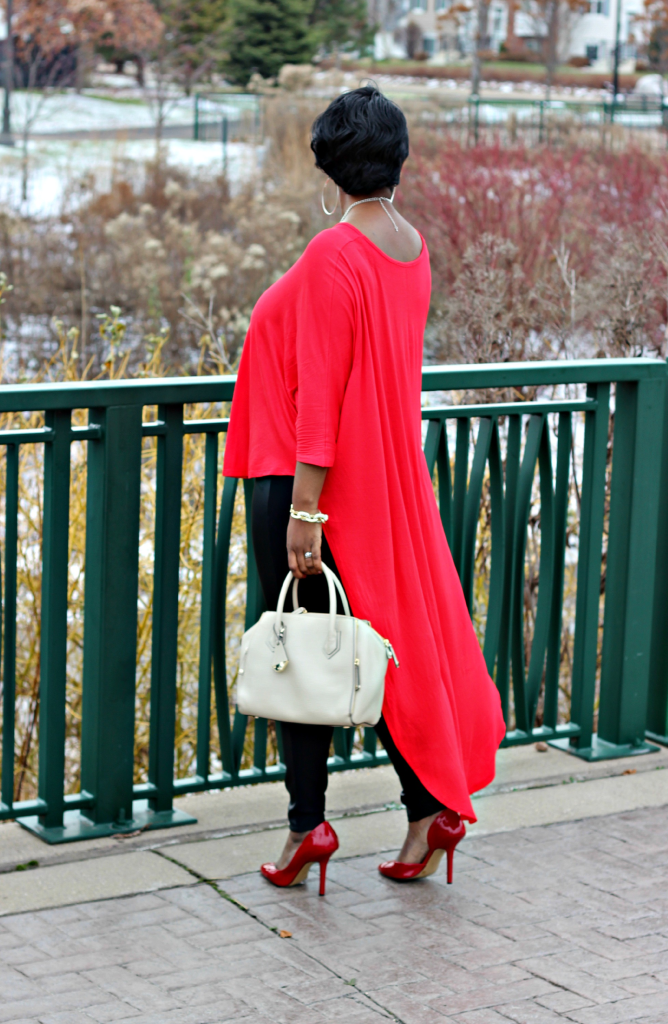 red high low duster and leather pants
