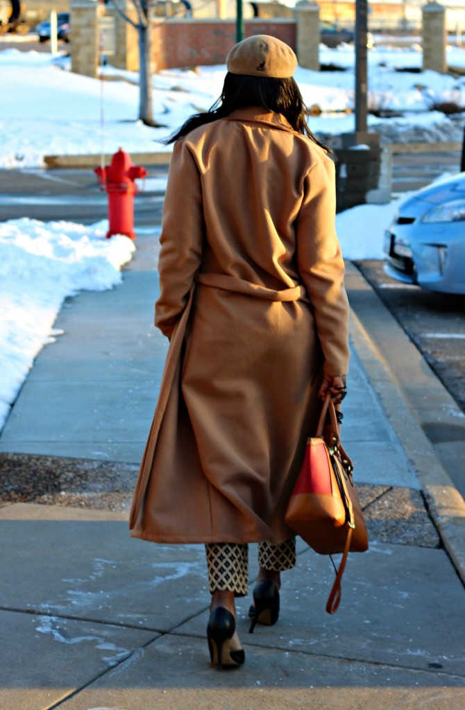camel coat and hat