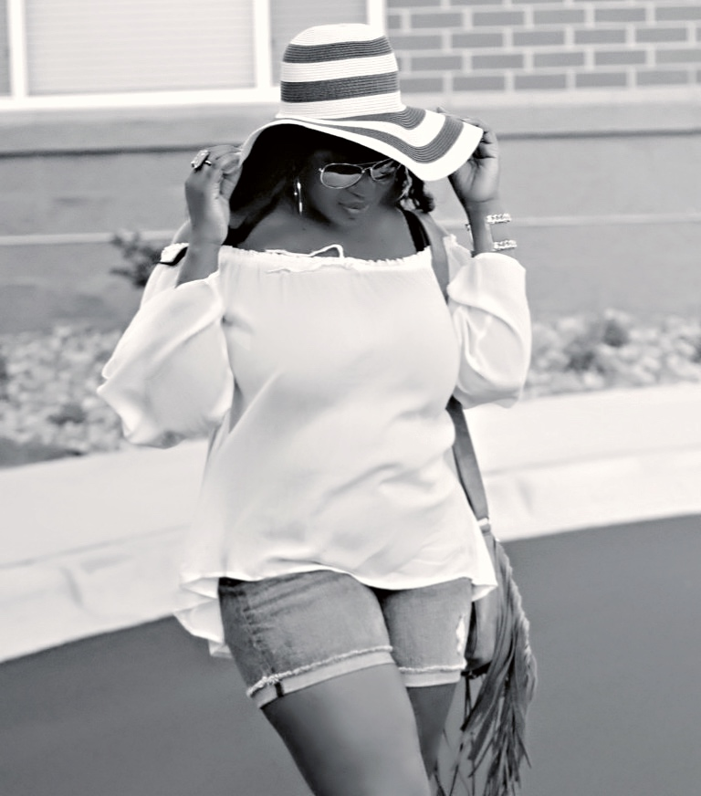 beautiful off shouder wite to and floppy hat and shorts