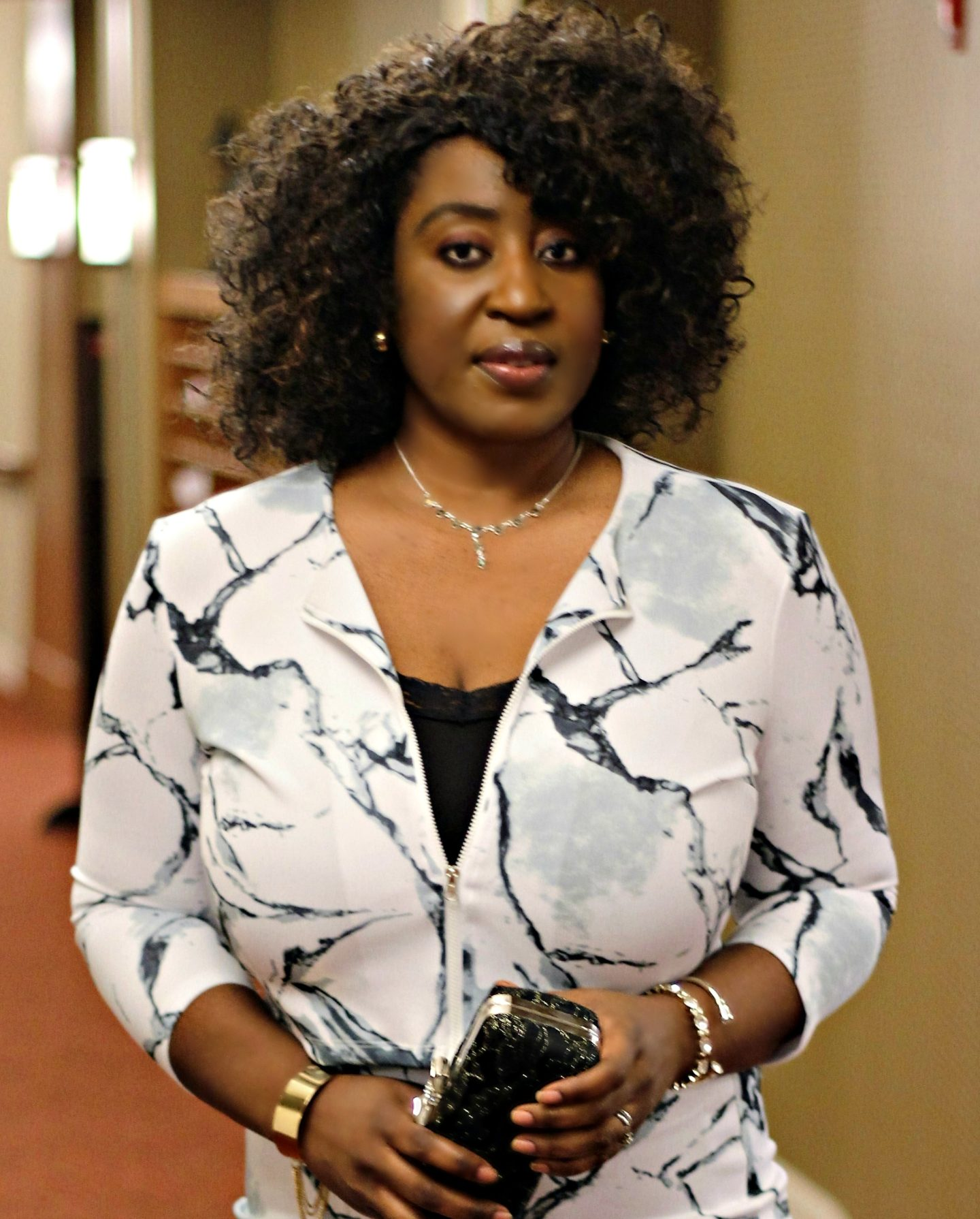 beautiful-black-woman-with-curly-hair-crop-top-skirt-set1jpg