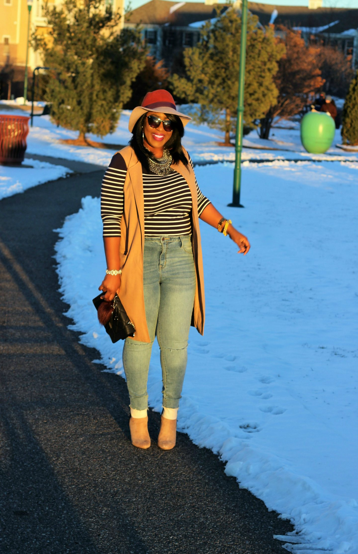 Camel-vest-stripped-top-colorblock-hats-and-justfab-boots