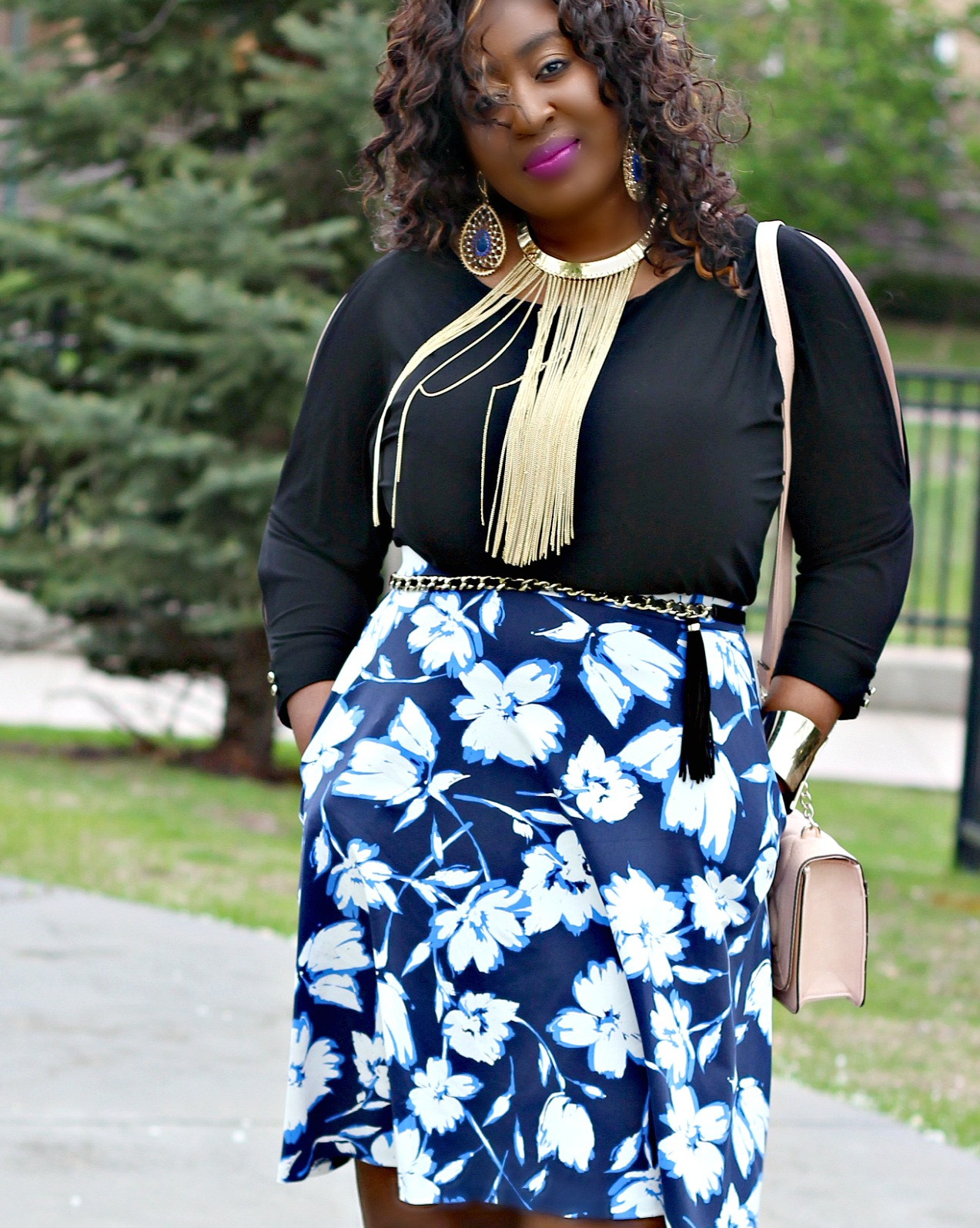 Floral-prints-skirt-and-statement-necklace