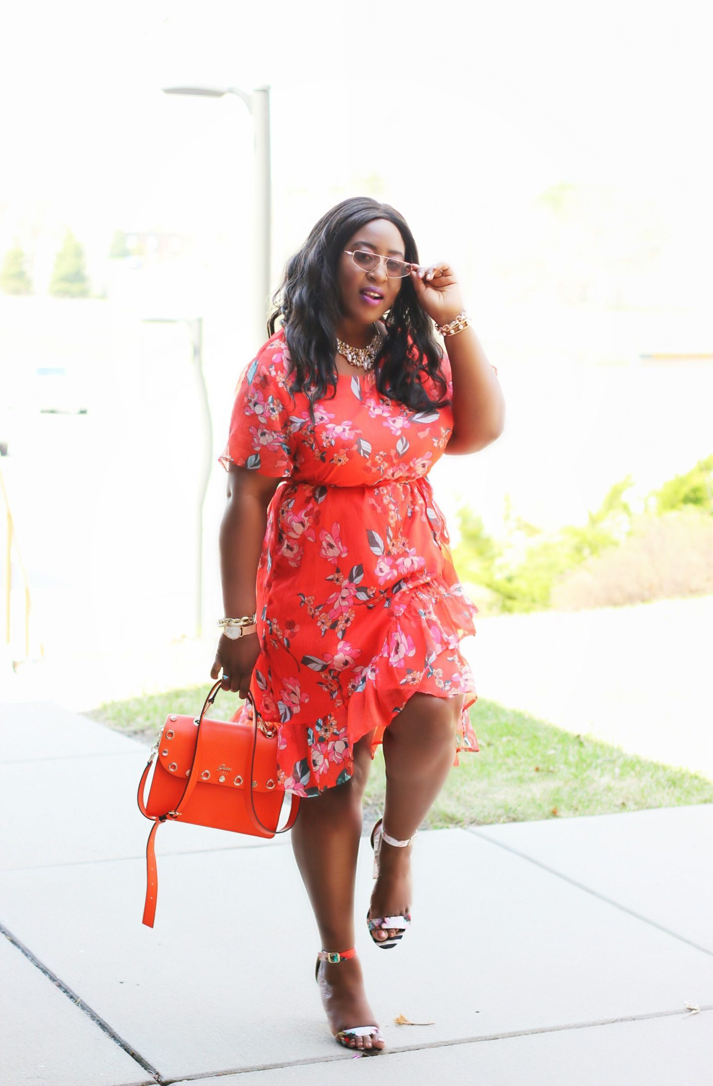 Black women in cute orange floral spring dress