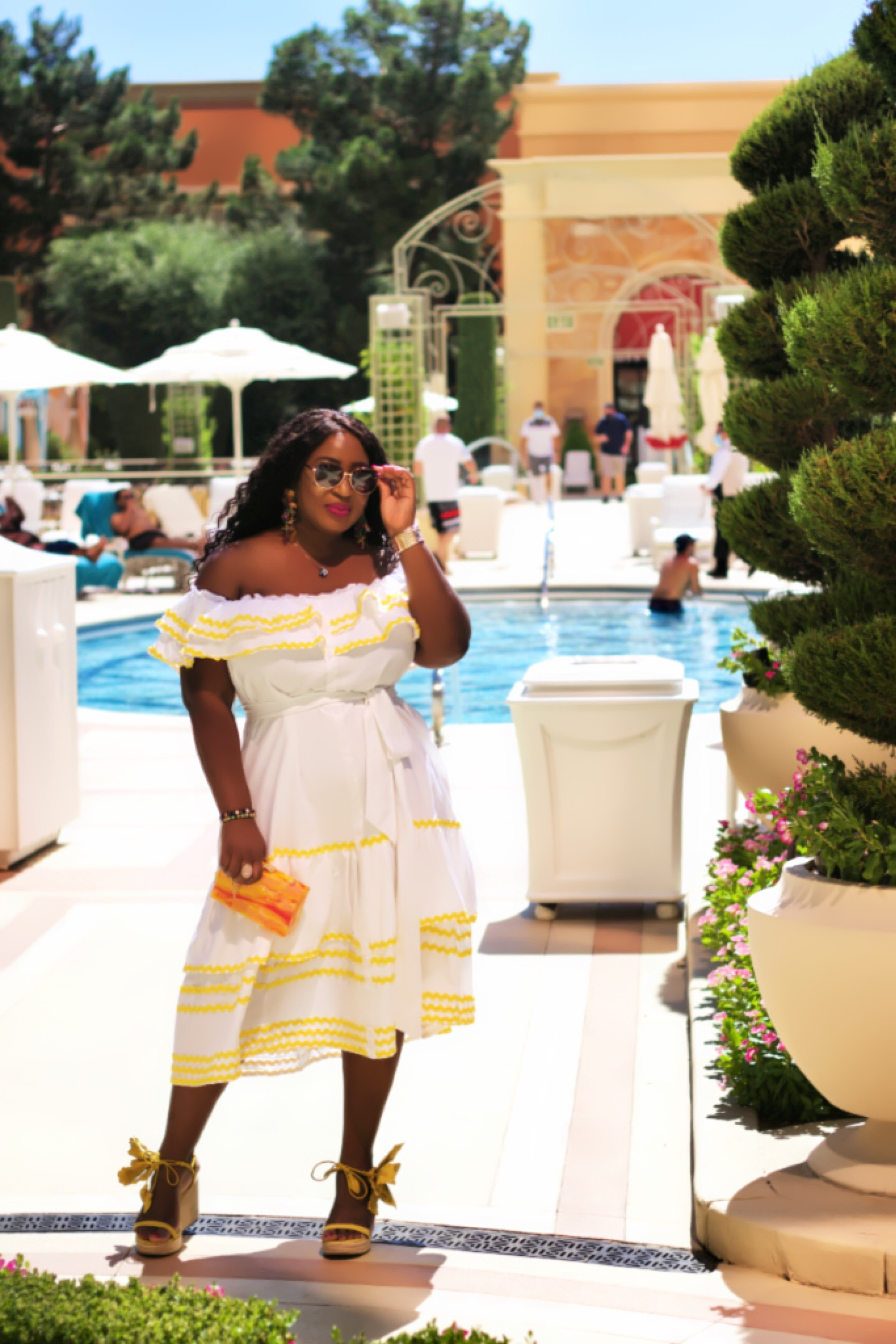 beautiful-white-fashion-dress-yellow-shoes-by-the-pool